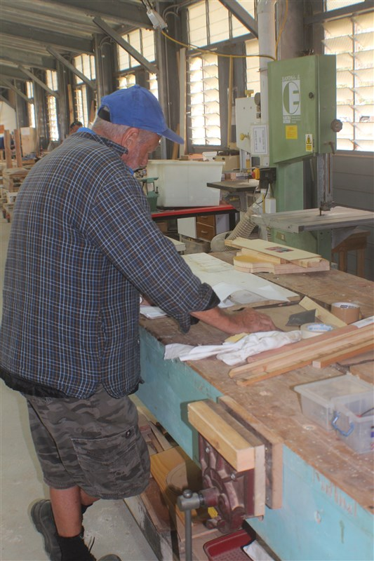 Plenty of work benches and wood working machinery